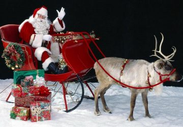 Santa On His Sleigh With Reindeer